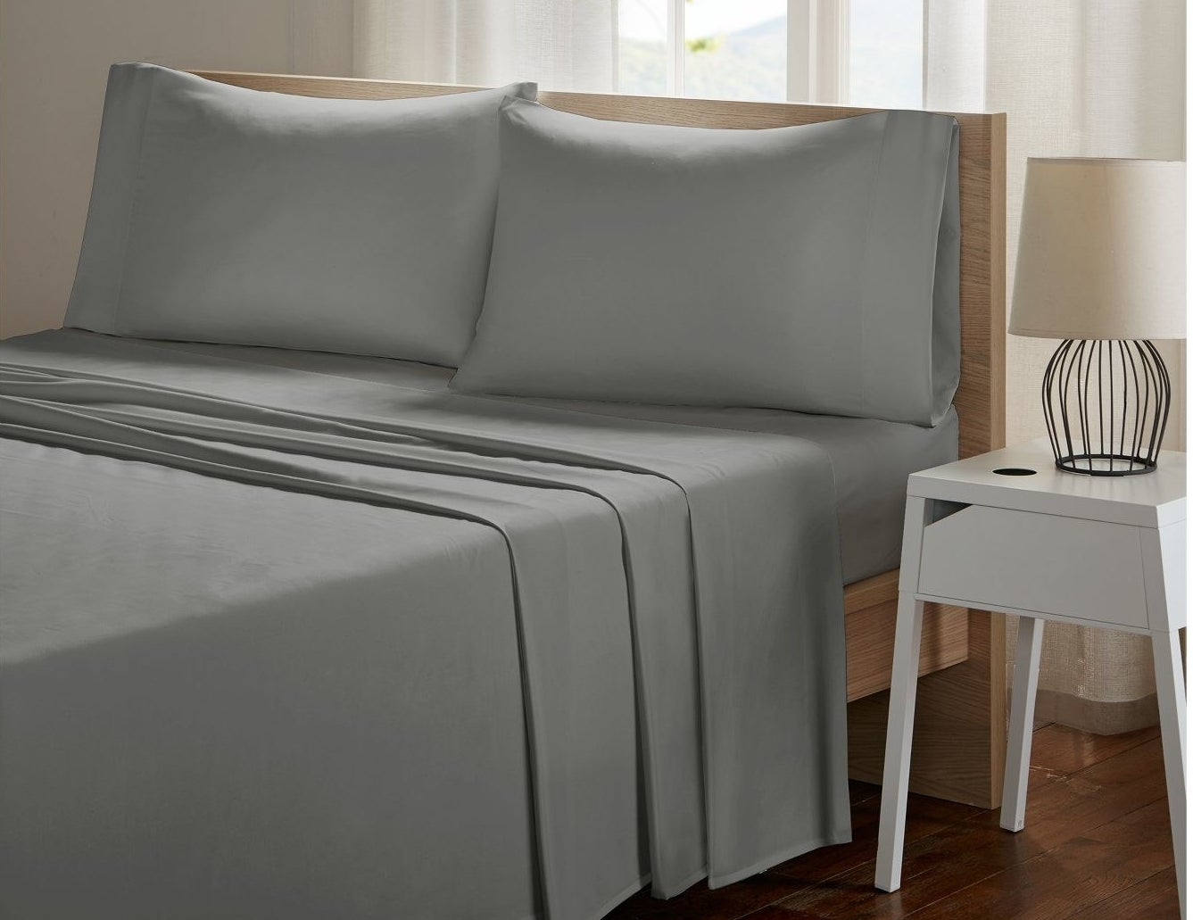 Light gray sheets and pillowcases properly displayed on a bed