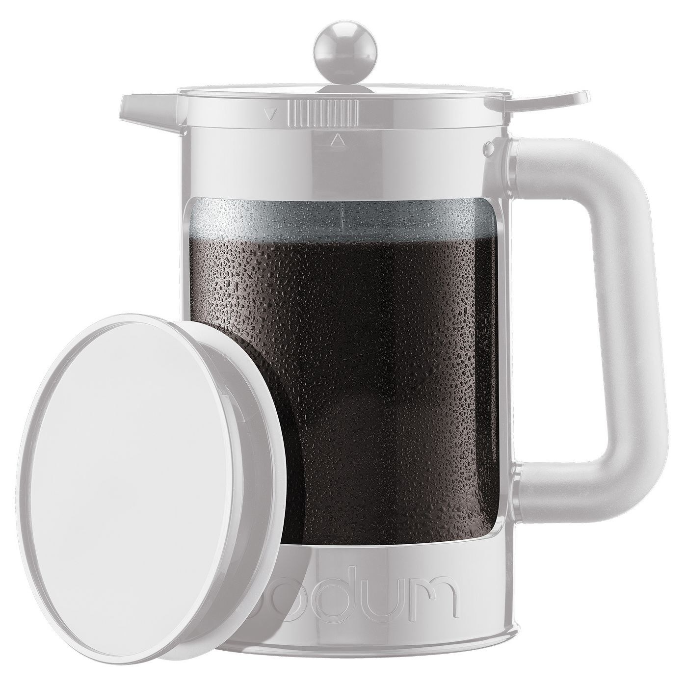A white coffee brewer with a clear jar filled with cold brew