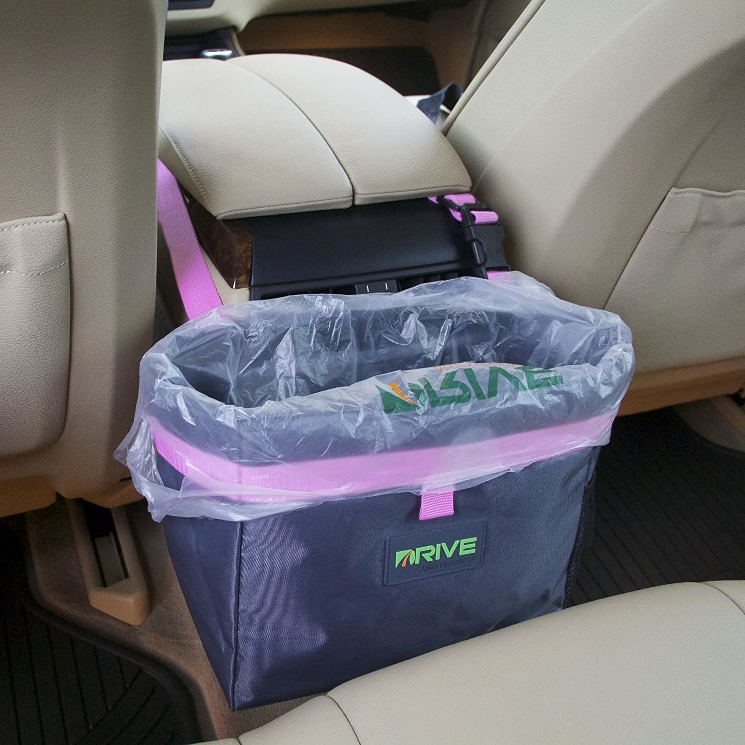 A car garbage bag attached to the centre console of a car