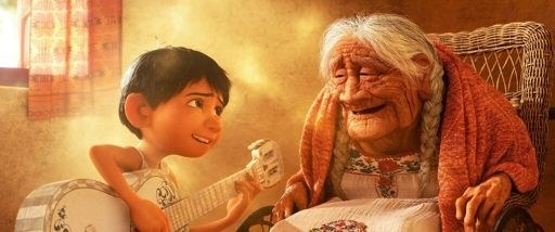 Miguel playing guitar and singing a song with Mamá Coco, helping her remember who her father was