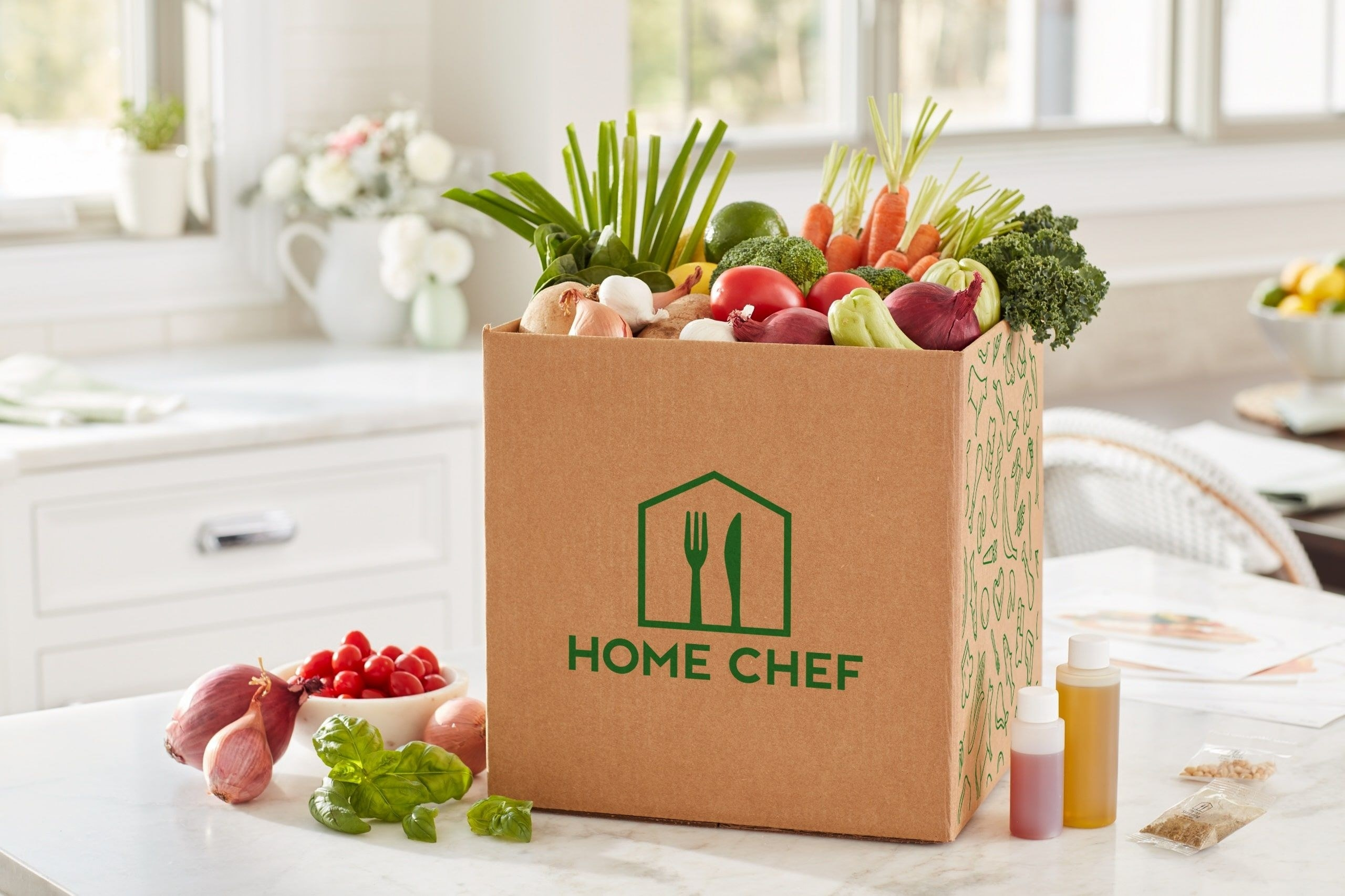 box with home chef on the side filled with veggies