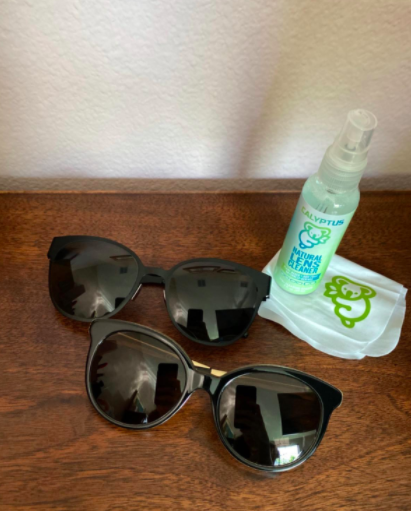 Reviewer's clean black sunglasses after using the eyeglass cleaner