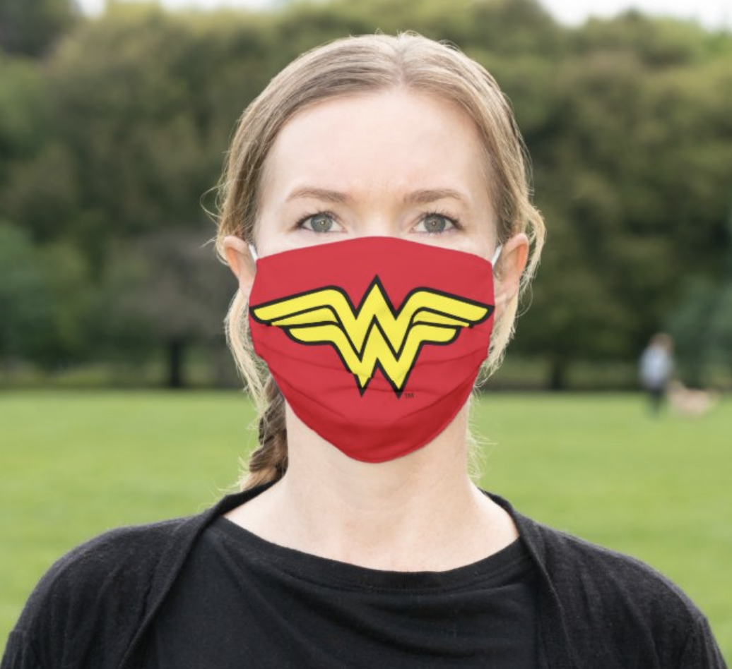 A model in a Wonder Woman face mask