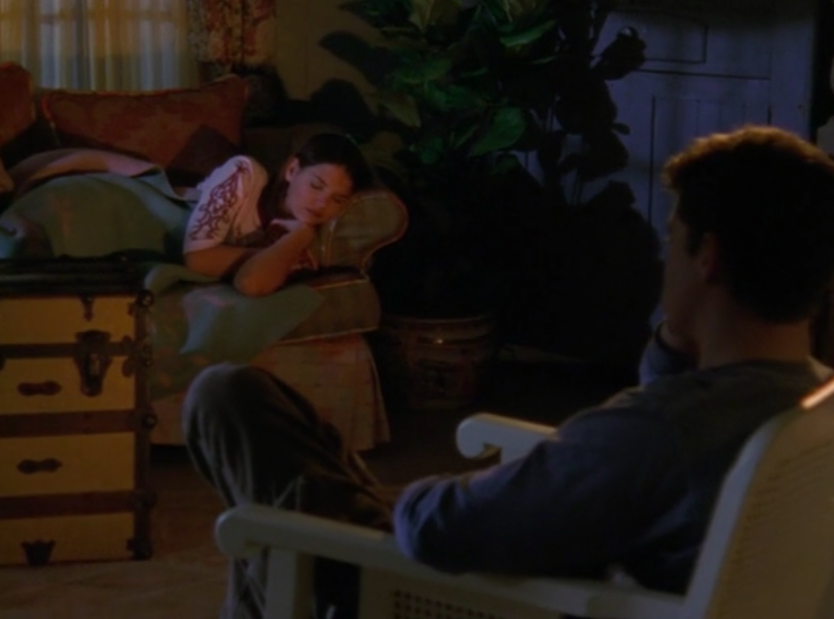 Pacey watches Joey sleep by the fire.