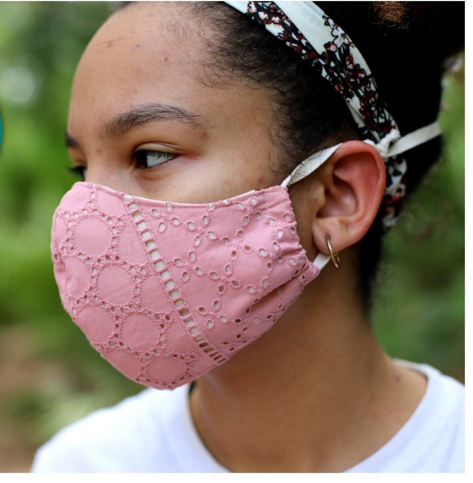 A model in a pink eyelet mask