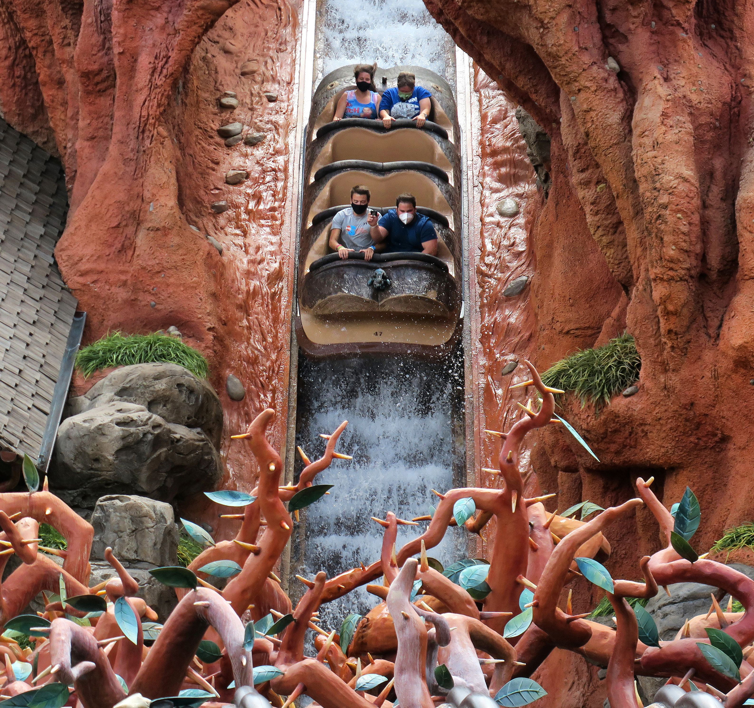 Four visitors ride Splash Mountain while separated by rows of seats