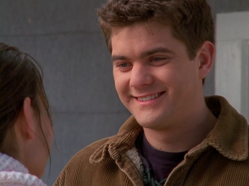 Pacey smiles at Joey before he teaches her how to drive.