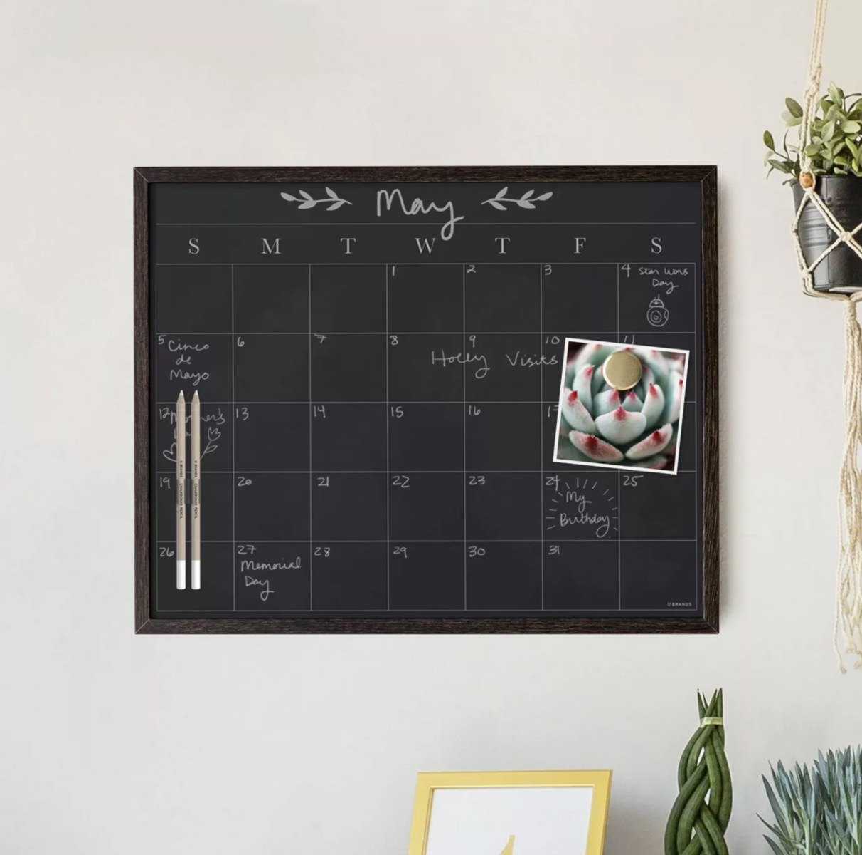 The chalkboard calendar on a wall