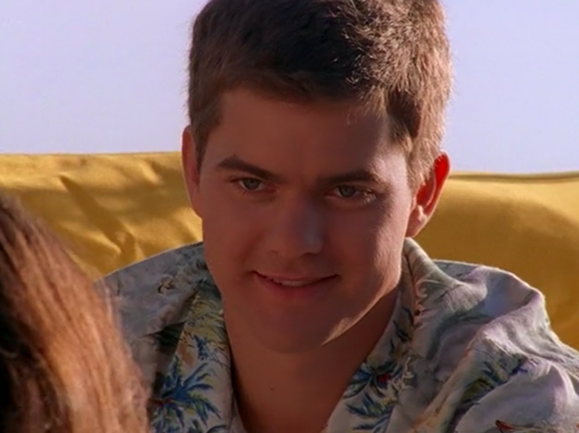 Pacey welcomes Joey onto the boat.