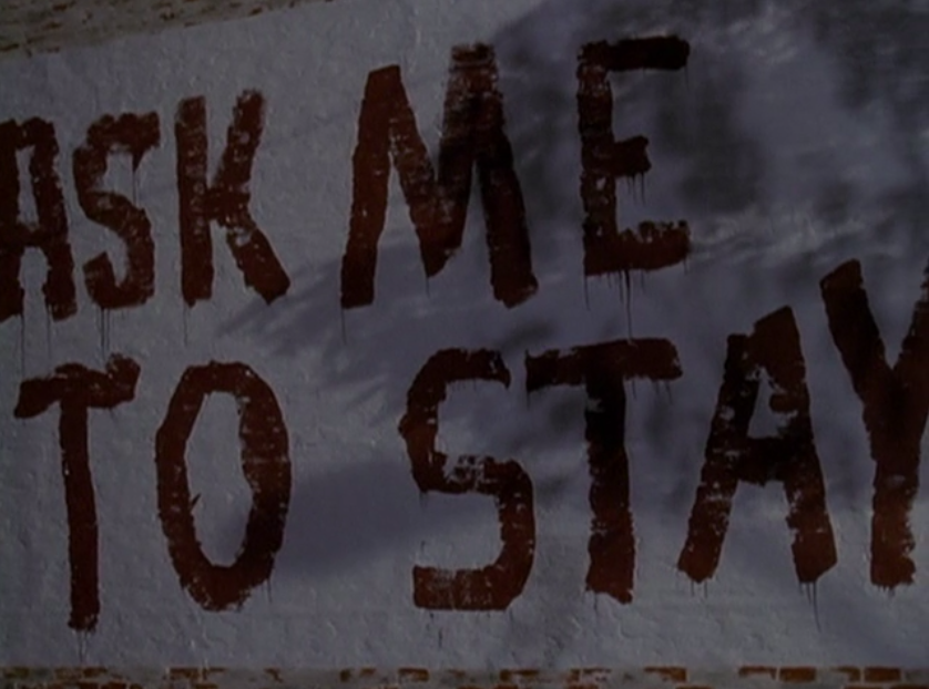"""Pacey has painted the wall that he bought Joey with the message """"Ask Me To Stay""""."""