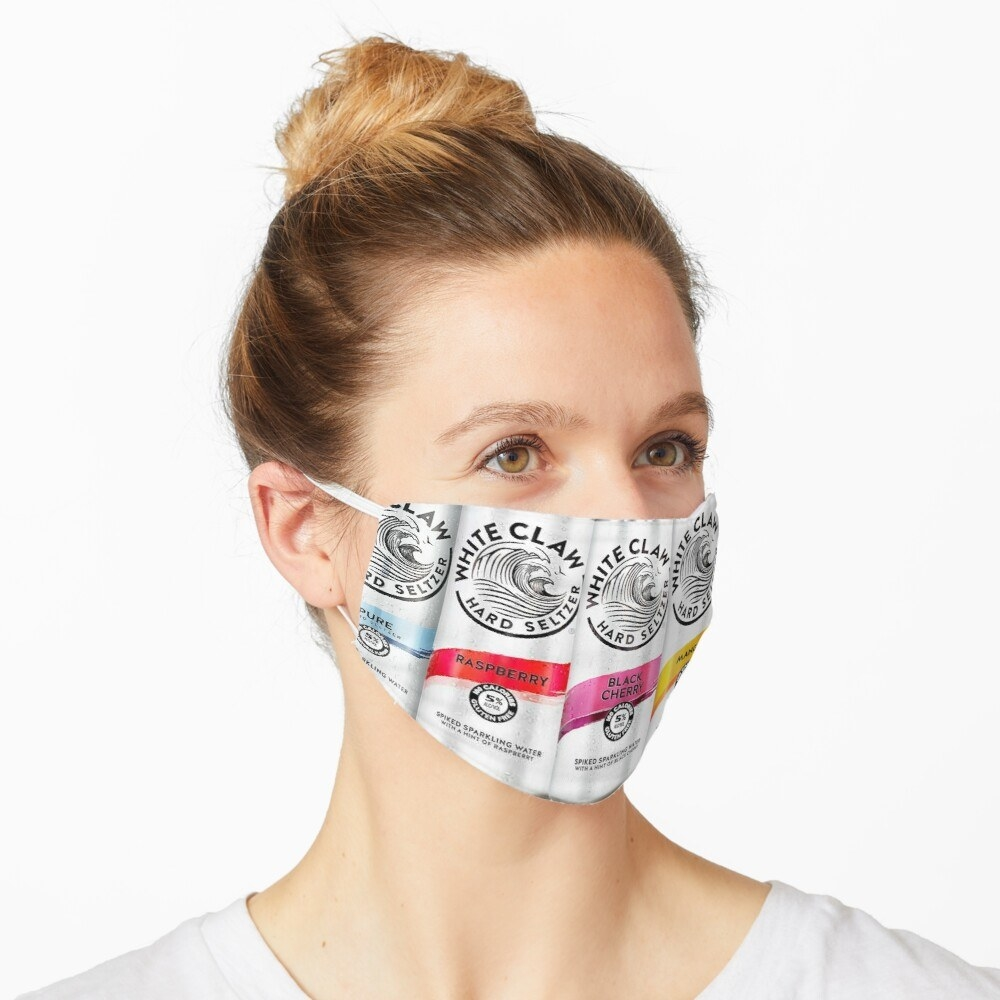 A model in a face mask with different White Claw cans on it