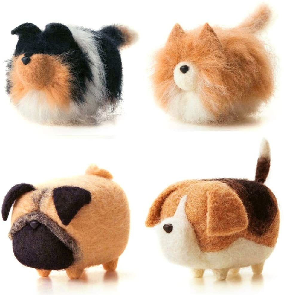 Four palm-sized needle felted dogs. There is a beagle, a pug, a sheepdog, and a collie.