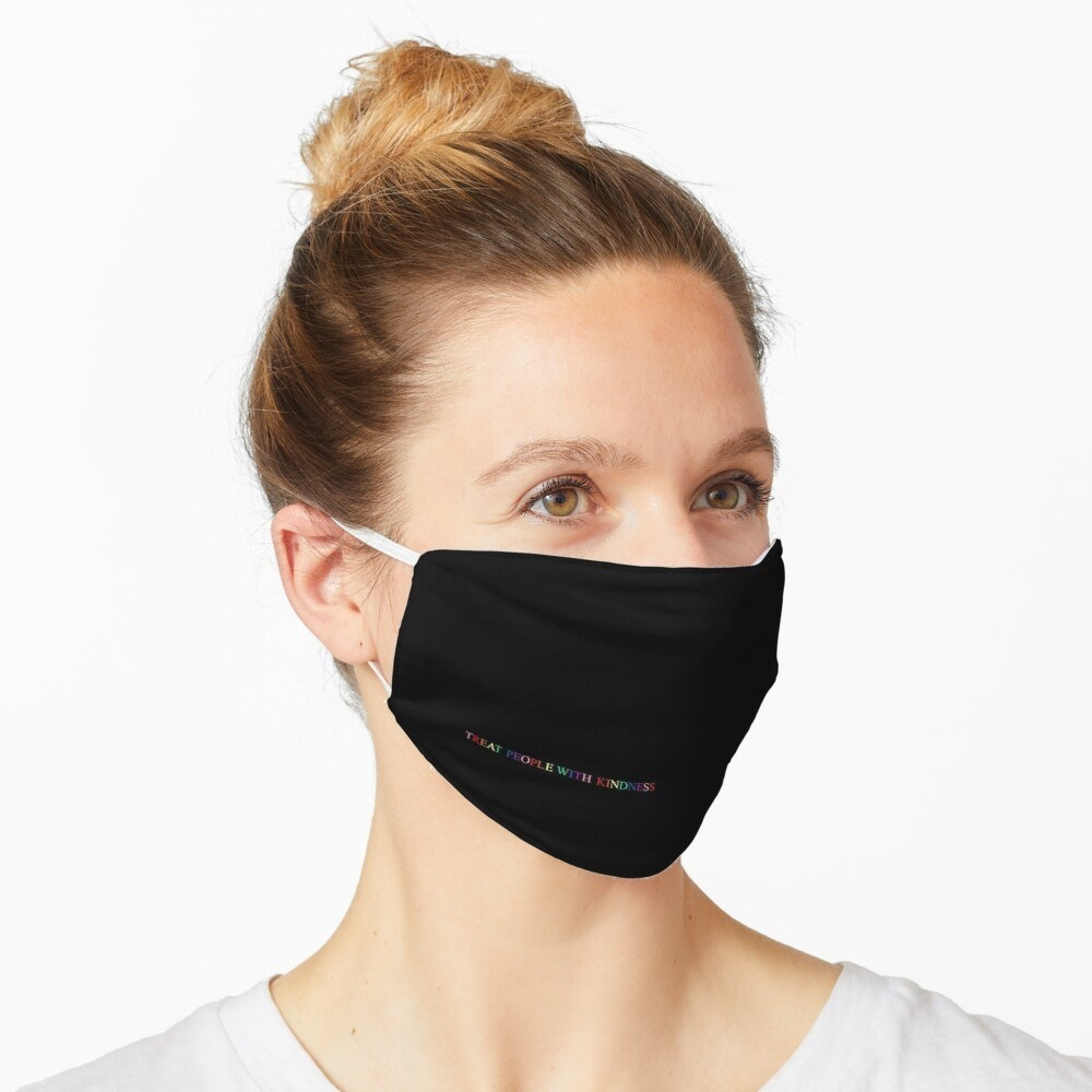 A black face mask with the rainbow message in the bottom right corner