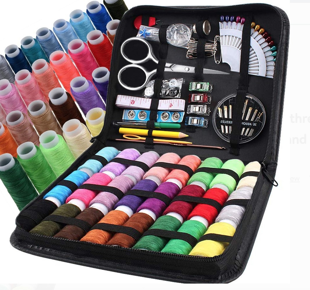 a sewing kit complete with various thread colors and tools