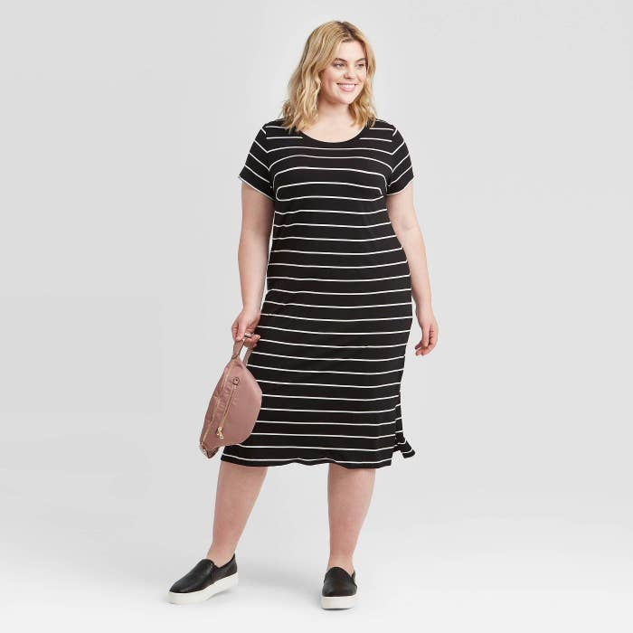 model wearing black and white striped midi dress