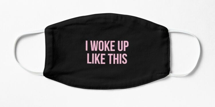 "A black mask with pink caps lock words ""I woke up like this"" in the middle"