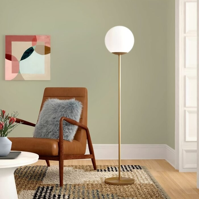 Emory floor lamp in gold with white plastic globe lampshade