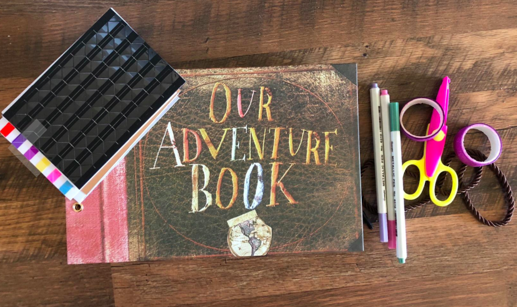 The Our Adventure Book laid out on a table.