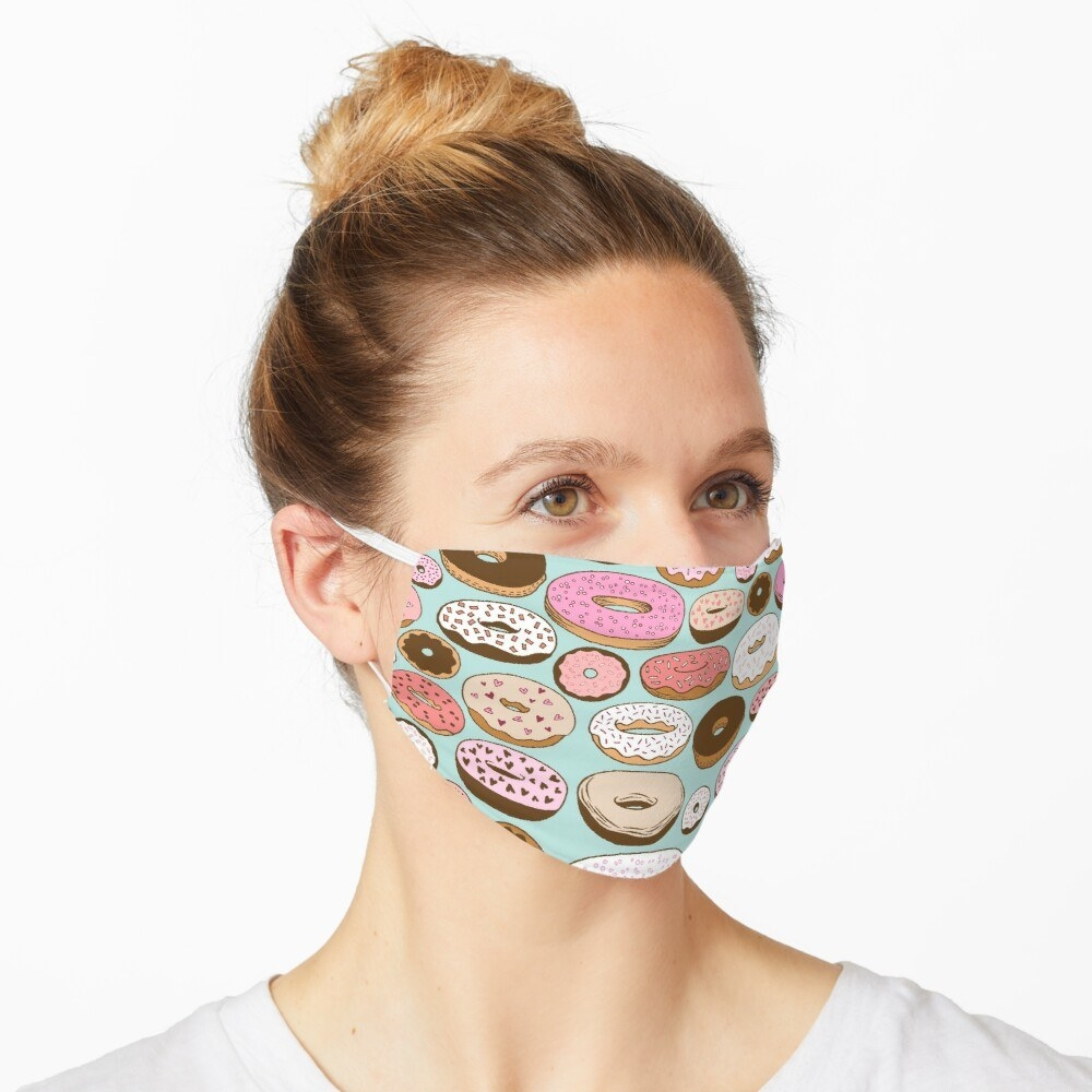 A model in a face mask with cartoon donuts