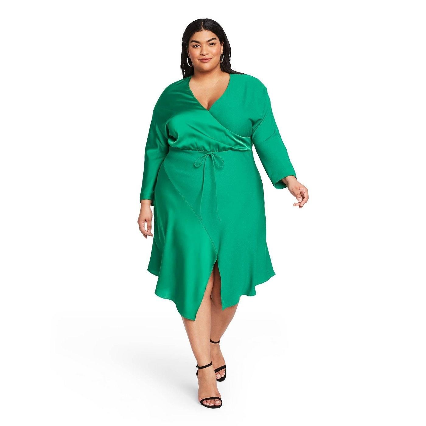 model wearing emerald green midi V-neck wrap dress