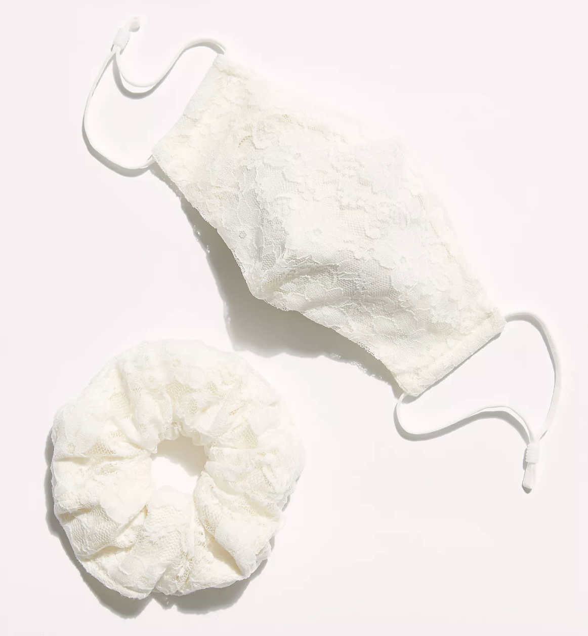 A white lace face mask and scrunchie