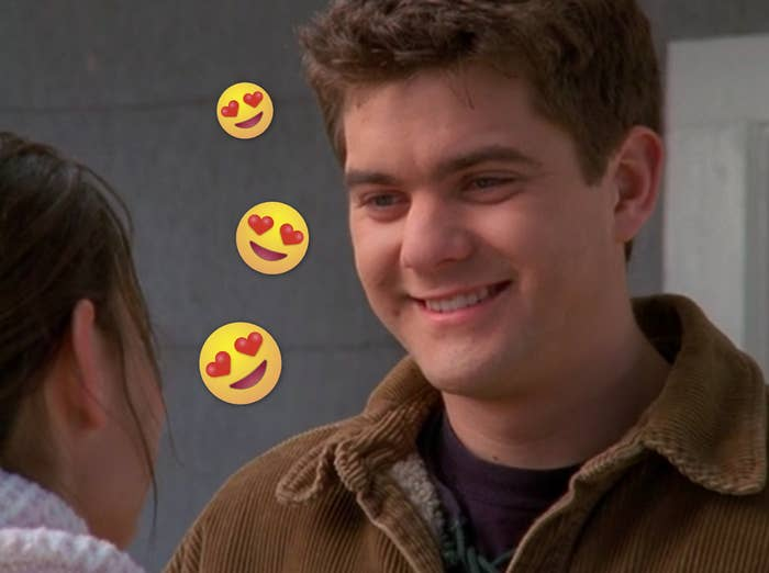 Pacey smiling at Joey with some heart eyes emojis on the photo.