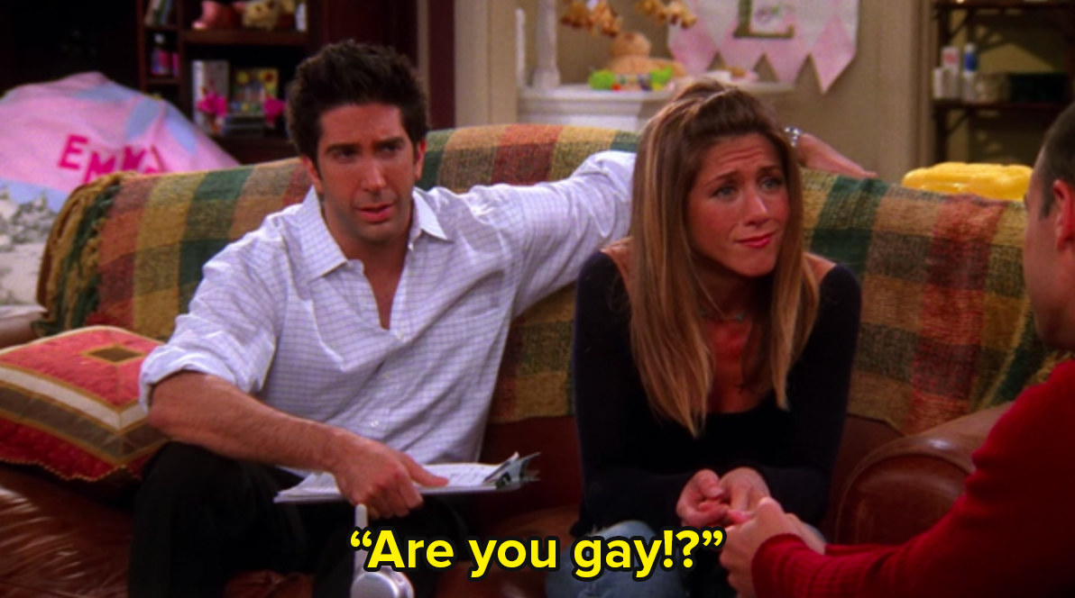 Ross and Rachel from Friends sit on a couch and Ross says are you gay to an unseen figure