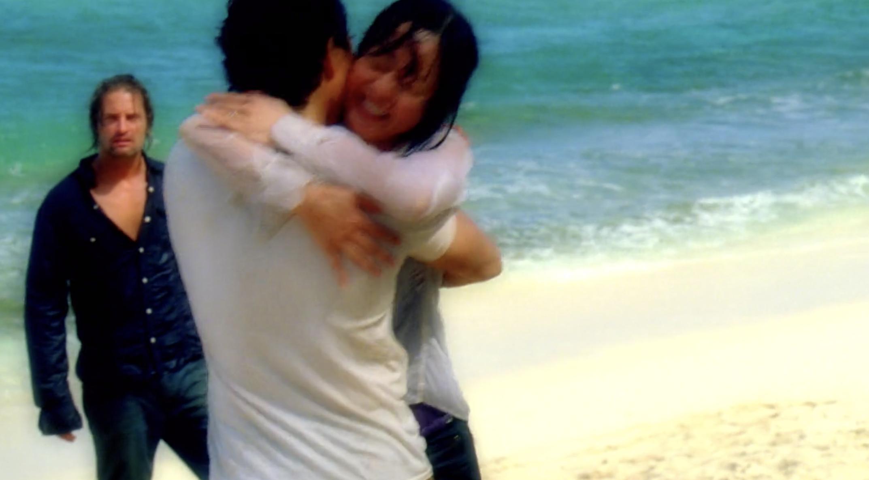 Couple hugs on the beach