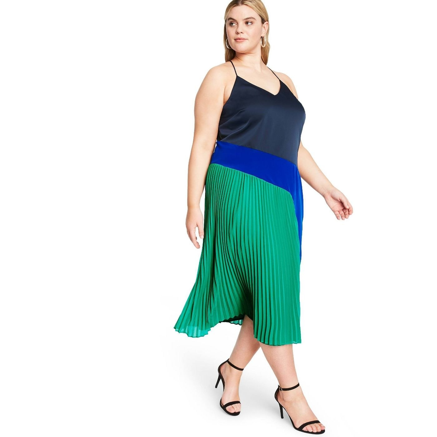 model wearing pleated tank dress with green, blue, and black colorblock