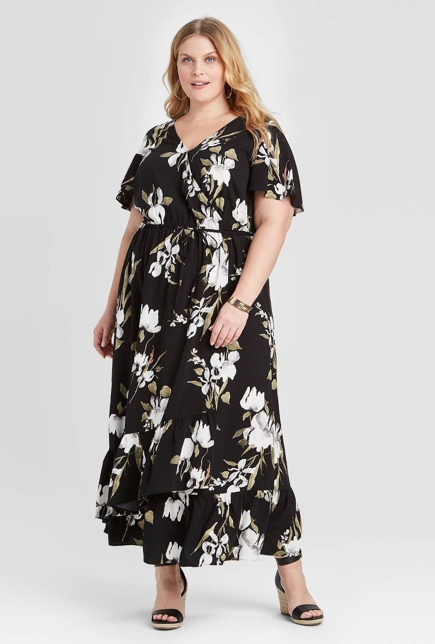 model wearing V-neck short sleeve maxi dress with white flowers