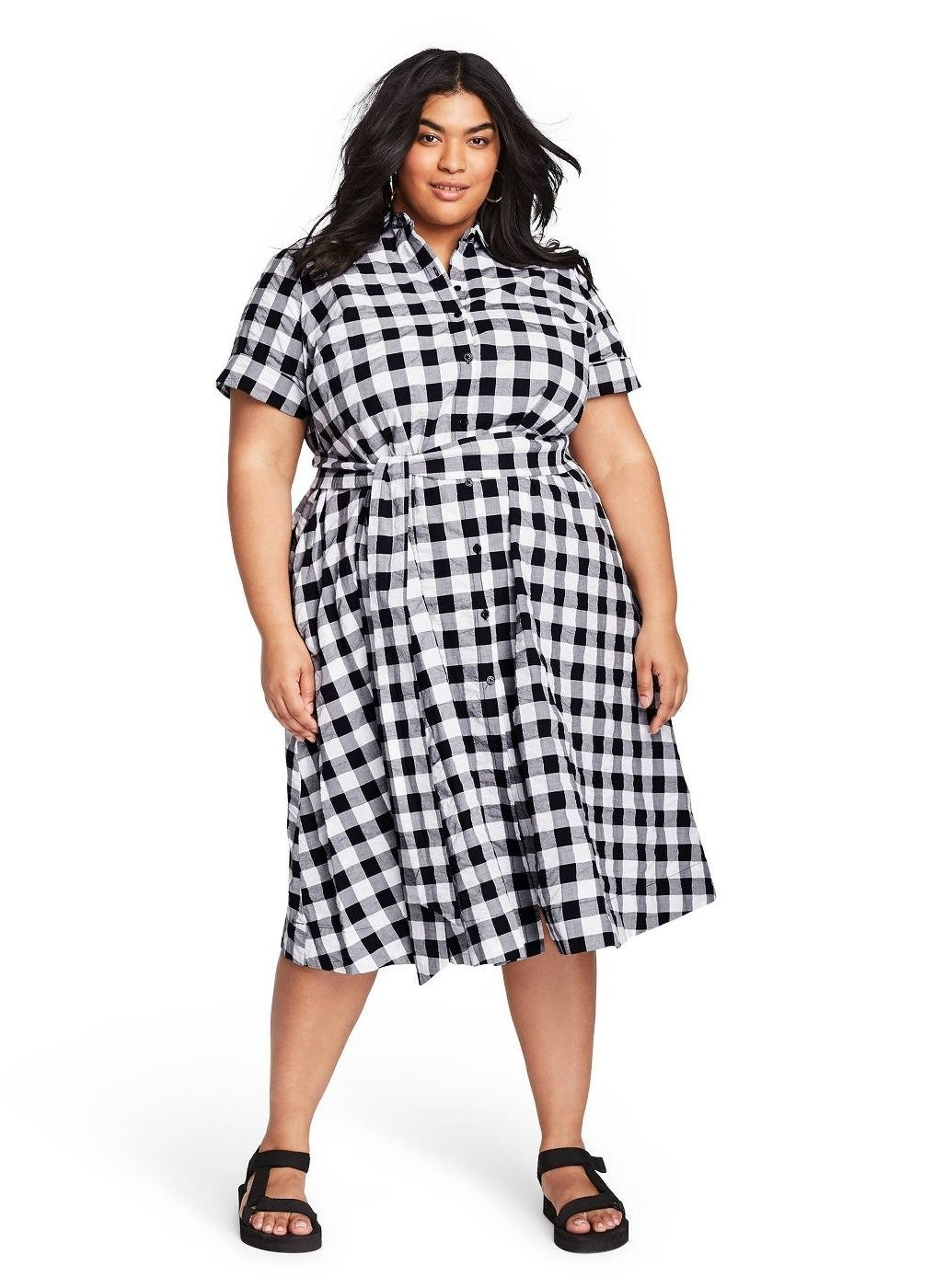 model wearing button-up black and white gingham midi dress