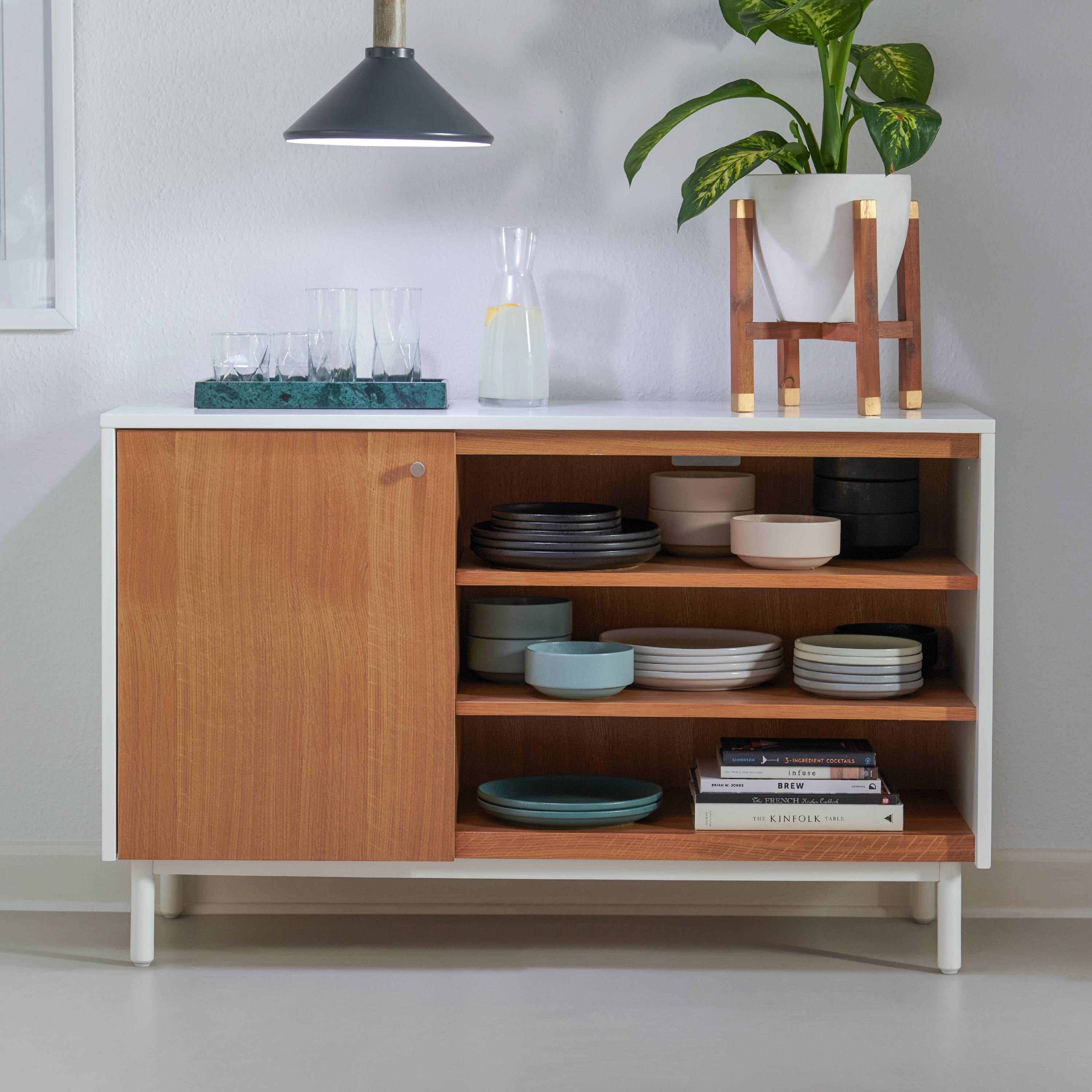 a credenza with a white exterior and table top and wooden medium brown cabinet and shelving