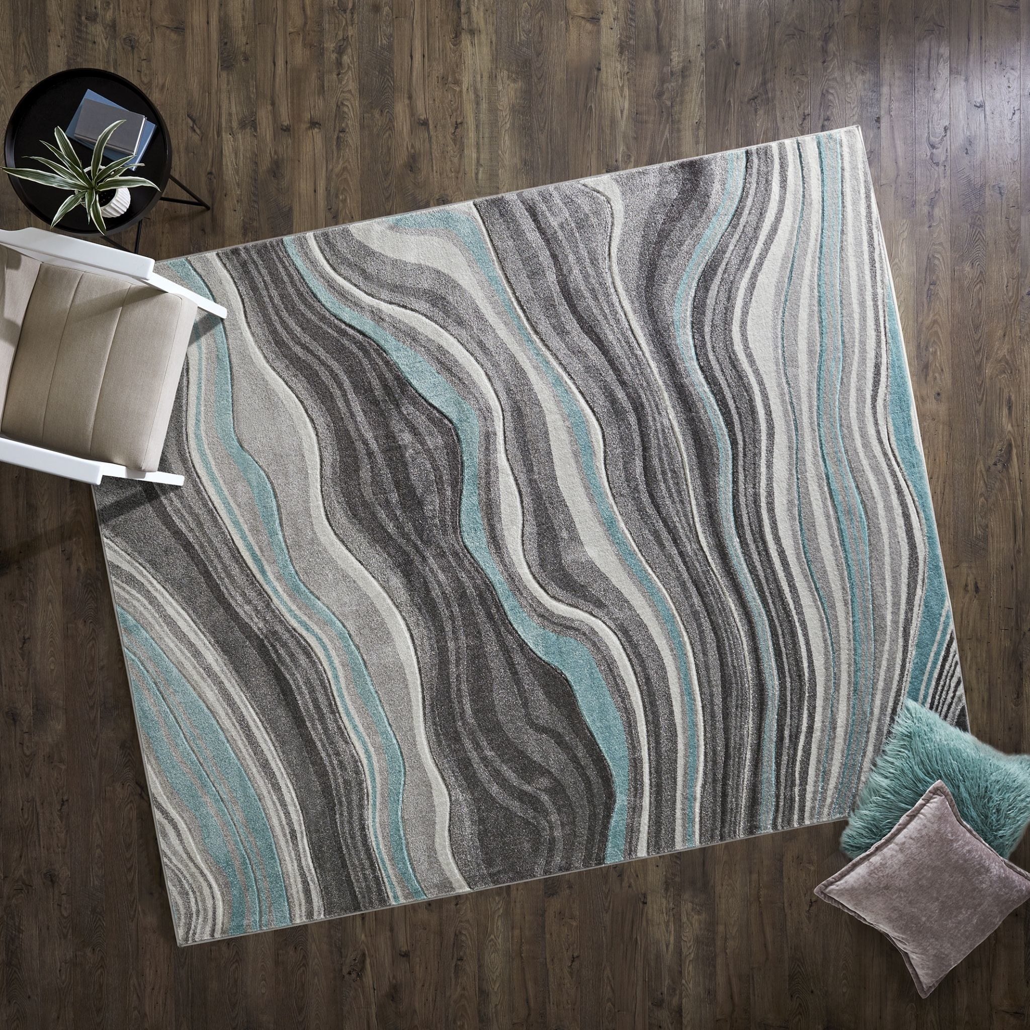 a rug with blue and grey swirls
