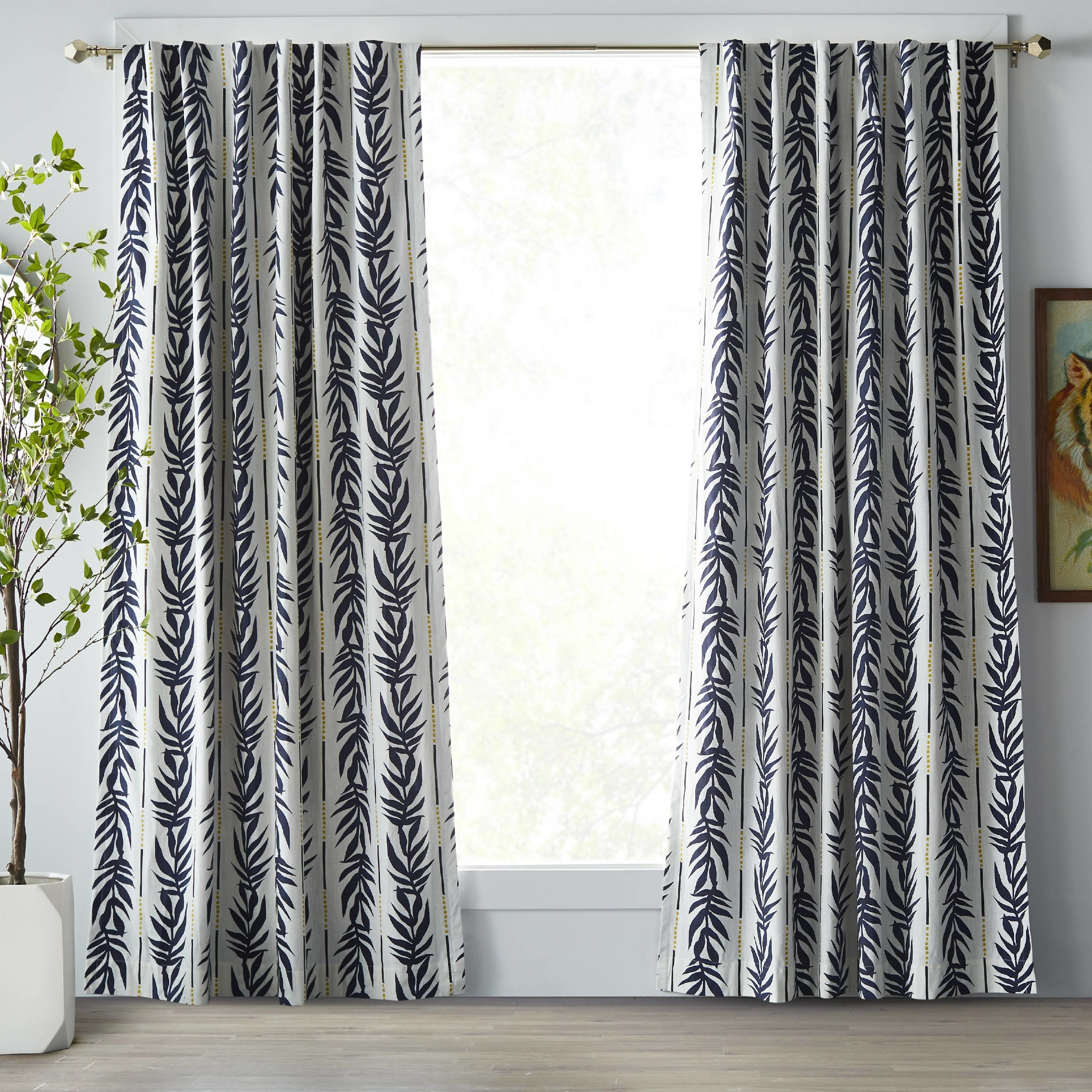 white and blue palm leaf patterned curtains