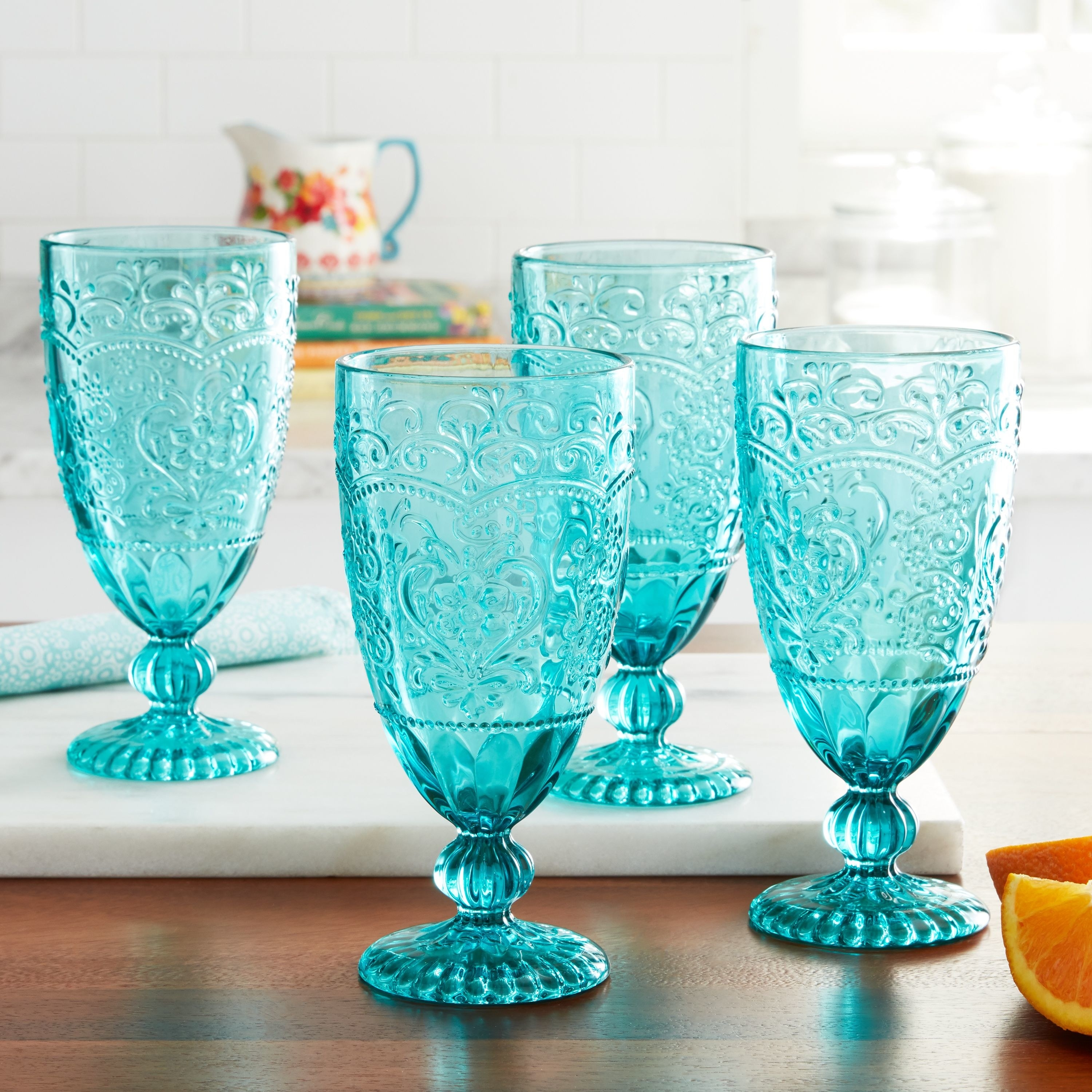 blue glasses with an embezzled design on them