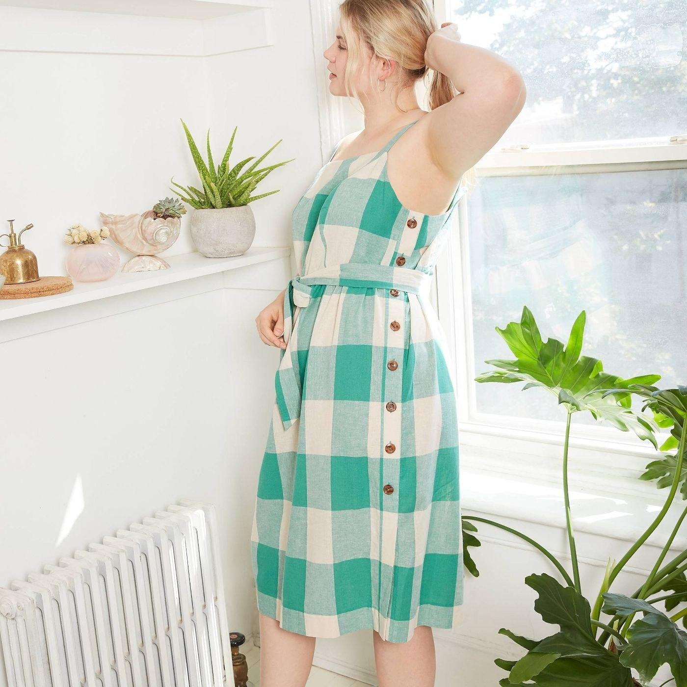 model wearing green and white gingham tank midi dress