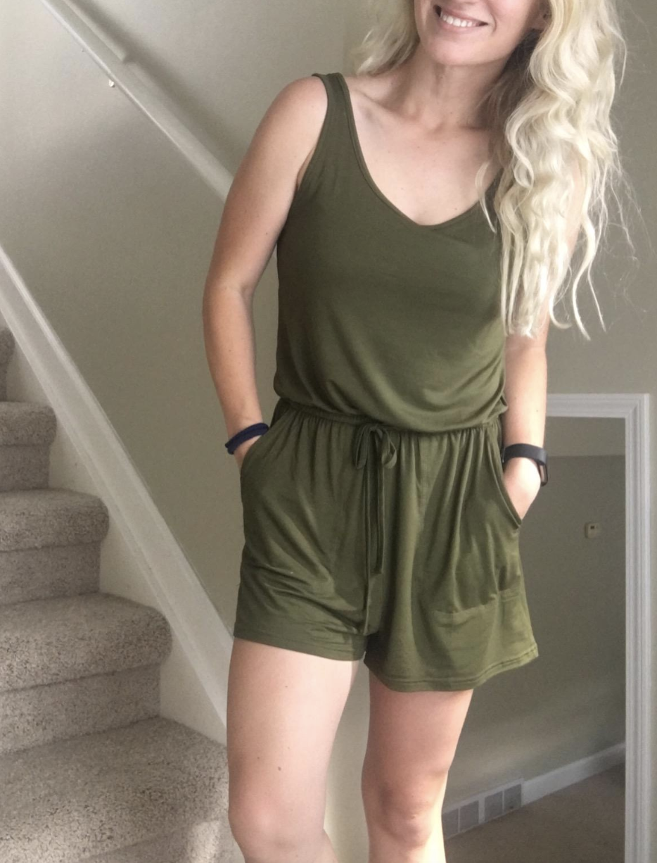reviewer wearing olive green romper with tie waist and pockets