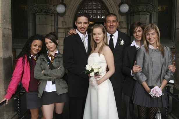 Janeece, Maxine, Donte, Chlo, Donte's dad, Brett, and Mika standing outside a church after the wedding