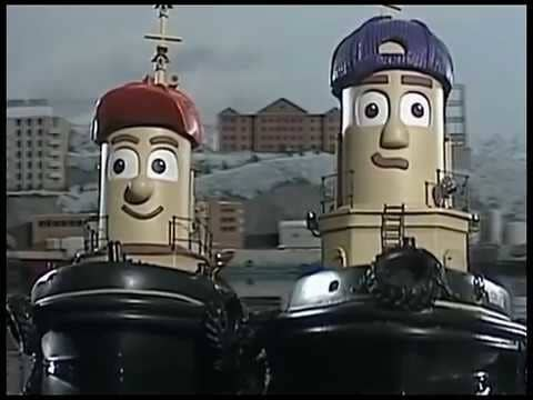 Two anthropomorphic tugboats with smiles on their faces