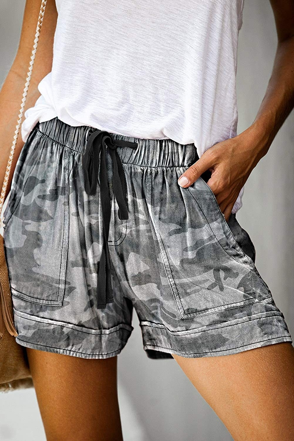 model wearing camouflage olive green linen shorts