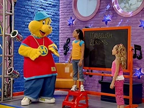 A man in a bear suit dressed in streetwear teaching children about stuff