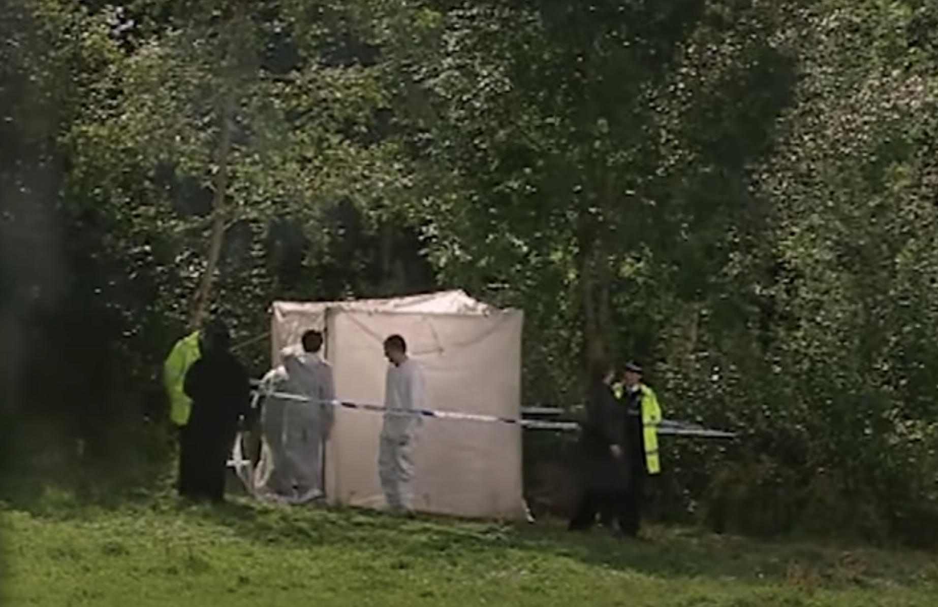 Forensic tent and police officers in the school playground