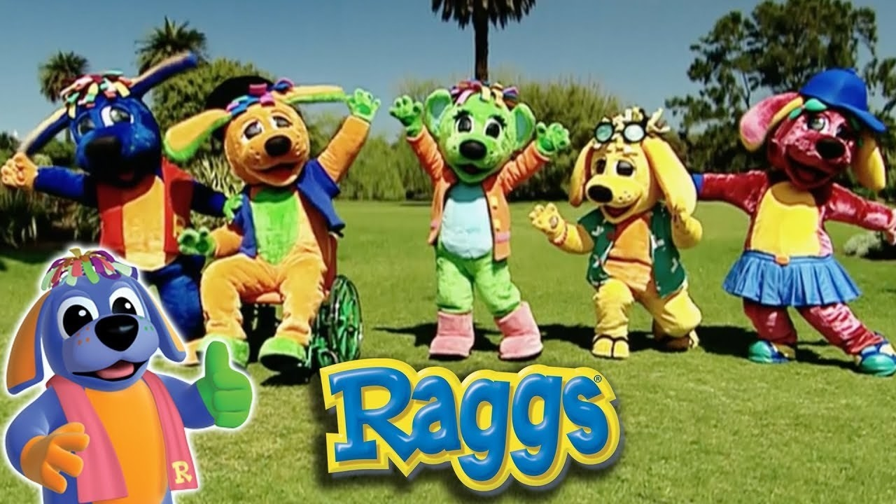A diverse group of costume dogs dancing in a field
