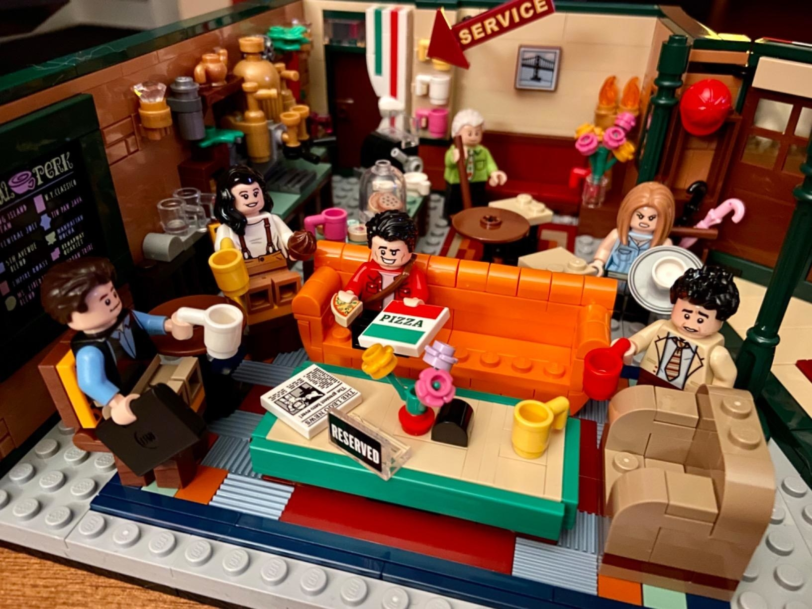 """A reviewer photo of the lego set complete with the cafe and characters from """"Friends"""""""