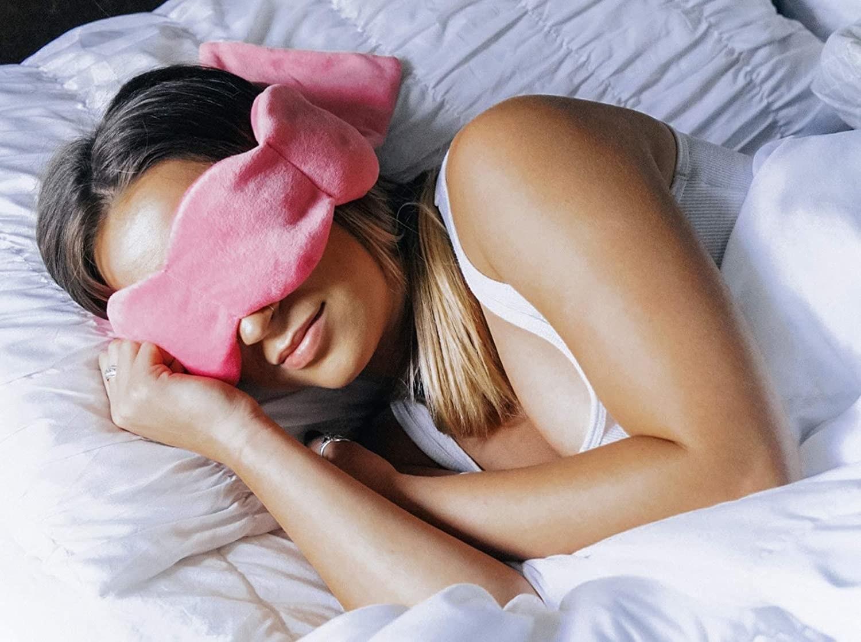 Model wearing wraparound fuzzy sleep mask