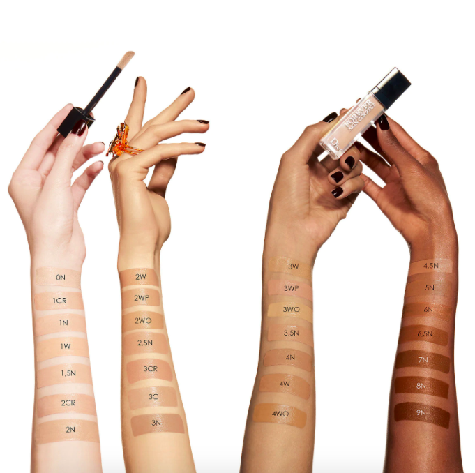 Four arms of different complexions show swatches of the Dior Forever Skin Correct Concealer in corresponding shades