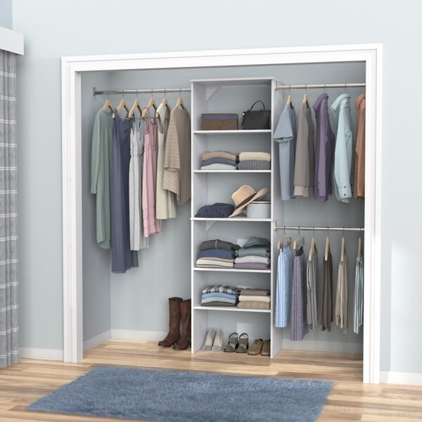 SuiteSymphony closet organization system in pure white featuring modular racks and shelves