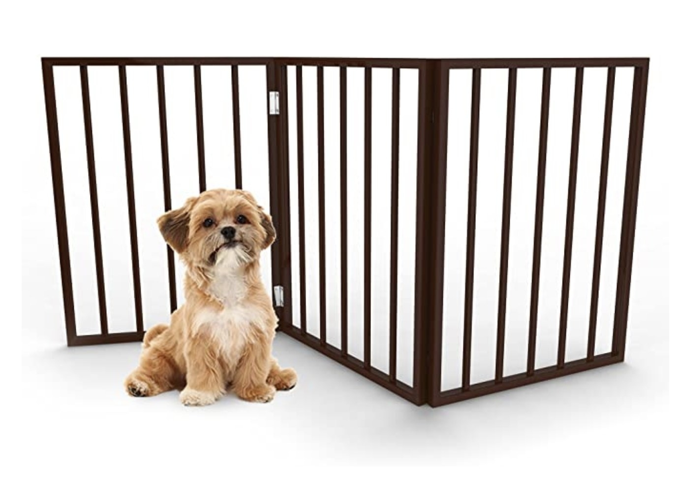 A puppy behind the pet gate