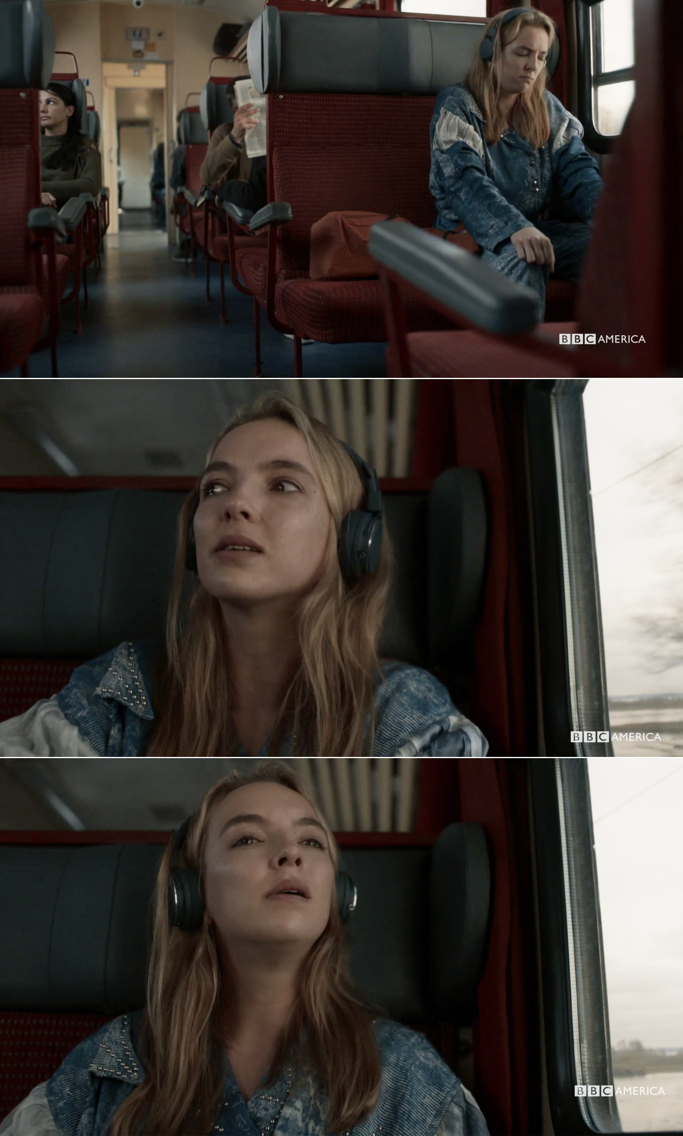 Villanelle looking out the window and crying on the train