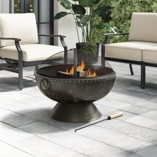 Tuscola round steel wood burning fire pit